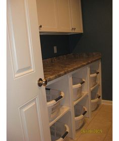 laundry room storage solutions - take cabinet doors off lower LR cabinets for sorting baskets