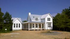 Chamfered Columns Installed | Batten board siding metal roof