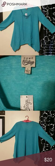 Turquoise Tunic BNWT Size Large Beautiful Turquoise Tunic by Como Vintage- V-neck- 3/4 sleeve  Super soft & lightweight 55% Rayon & 45% polyester Como Vintage  Tops