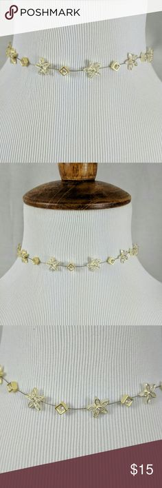 ✨ Holiday Sparkle✨Nine West Gold & Silver Choker🍸 ✨Holiday Party Sparkle🍸 Flowers and little diamond shaped charms on fine cable wire Each has a crystal center Both gold and silver to go with any color scheme Adjustable lobster clasp Beautiful for gift giving 🎁 Nine West Jewelry Necklaces