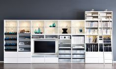 Awesome collection of Ikea Book Shelf units...making a fabulous Entertainment Center