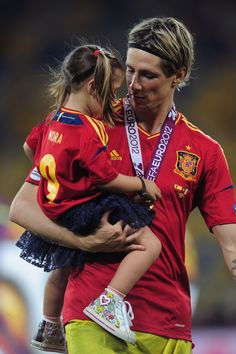 Fernando Torres Photos Photos - Fernando Torres of Spain celebrates their victory with his daughter Nora Torres after the UEFA EURO 2012 final match between Spain and Italy at the Olympic Stadium on July 1, 2012 in Kiev, Ukraine. - Spain v Italy - UEFA EURO 2012 Final