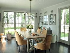 Dining room | The framed pictures of the kids make this space so cozy