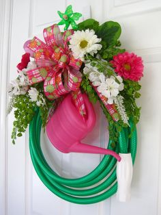 Spring Flower, Hose, & Watering Can Wreath I feel this is something you need Wreath Crafts, Diy Wreath, Door Wreaths, Garden Hose Wreath, Pink And White Flowers, Garden Crafts, Summer Crafts, Summer Wreath, How To Make Wreaths