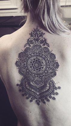 Mandala back piece. Line work tattoo.