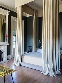 Make ceilings look sky high with a low bed and glamorous curtains on your four post canopy bed!
