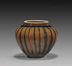 """Charming Chinese Song/Jin Dynasty, Henan glazed jarlet; of good high-shouldered for, with fine iron-rust striped all around the exterior; H: 3 3/4""""; Provenance by repute: The Collection of A. Alexander"""