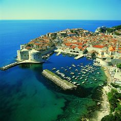 Dubrovnik is a city on the Adriatic Sea coast of Croatia, positioned at the terminal end of the Isthmus of Dubrovnik. It is one of the most prominent tourist destinations on the Adriatic, a seaport and the centre of Dubrovnik-Neretva county. Unique Honeymoon Destinations, Travel Destinations, Montenegro, Dream Vacations, Vacation Spots, The Places Youll Go, Places To See, Bósnia E Herzegovina, Croatia Travel Guide