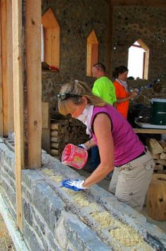 """Foundation of cordwood construction - Spreading insulation, cleaning log ends and tuck pointing are all parts of learning the """"technique."""""""