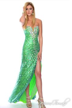 Large gemstones draw attention to this gown's deep-V neckline and sky-high slit. Sequins, colors, neckline, everything...