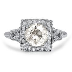 The resplendent Art Deco reproduction Angelic Ring features a dazzling old European cut diamond center surrounded by a glistening geometric halo of round brilliant diamond accents. Intricately pierced details on the gallery and milgrain edges add to the fantastic look of this 18K white gold ring. #BrilliantEarth