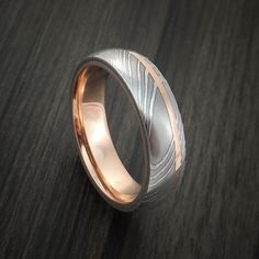Damascus Steel 14K Rose Gold Ring Wedding Band Custom Made. Way pretty, why does it have to be for a wedding? I just want one.