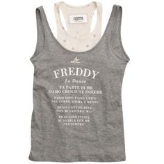 This tank top with a deep round neck looks like two shirts layered one on top of the other. It comes from Freddy's Dance Glam Attitude line. Wear it to the gym or for dance class, with leggings, for example, for a fashionable and feminine look. - Round neck and double, superimposed straps - Over-shirt made of printed fabric and undershirt decorated with polka dots - Made of pure cotton jersey