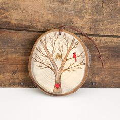 Snowy, winter tree with red cardinal and heart. Custom wood slice ornament or magnet. Personalized wood burned heart, with or without snow by ForageWorkshop on Etsy https://www.etsy.com/listing/219950032/snowy-winter-tree-with-red-cardinal-and