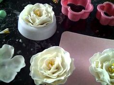 how to make a simple elegant gumpaste fondant flower - YouTube