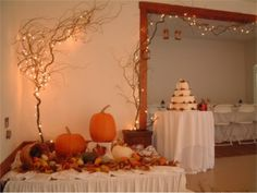 I'm loving the lights in the tree and archway. #fall #wedding