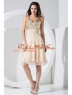 Champagne Prom / Cocktail Dress With Sequins Knee-length Chiffon V-neck  http://www.fashionos.com  sleeveless prom dress | chiffon prom dress | empire prom dress | zipper up prom dress | knee length prom dress | under 150 prom dress | v neck prom dress | 2013 prom gowns | champagne prom dress |  This short party dress is a power play of sweet and sassy. This fabulous dress features a v neck on the sequined bodice with a ruched waistband curves the dress on the empire waist.