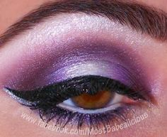 Give your eyes a sultry feel with a deep purple smokey. Add a touch of glitter liner.