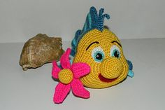 Look what a miracle sailed out of a fairy tale about the Little Mermaid!  Fish Flounder - funny, smiling and very cute baby.