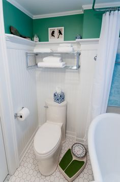 Traditional Bathroom by Nathan J. Reynolds.  Wainscotting with molding, cheaper than tile molding and tiled wall.