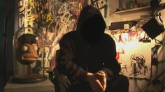 Banksy in his studio, conducting an interview with NPR on whether his film about street art is real or a hoax
