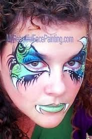 Creepy and feminine dragon eyes face paint. Homemade Fab split in blue and light… Monster Face Painting, Dragon Face Painting, Eye Face Painting, Mime Face Paint, Face Paint Makeup, Face Painting Designs, Face Art, Eye Makeup, Face Paintings