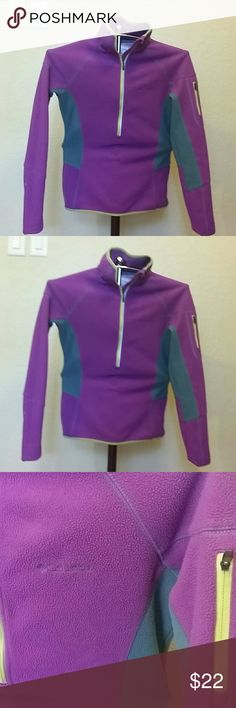 Women's Columbia1/2 Zip Eggplant LS Fleece, Sz. S Omni-H3eat Thermal Comfort, 92% Polyester and 8% Elasthane, Eggplant, Yellow, and Gray colored.  Zip pouch on left upper arm.  Chest: 36 inches at the bust - pit to pit.  Form Fitting.  Excellent Used Condition: MSRP $ 60, Sz. S/P, 1/2 Zip Columbia Tops Sweatshirts & Hoodies