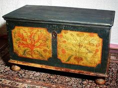This is a great early six board Peasant Art painted blanket chest. Mustard yellow fielded panels on the green background