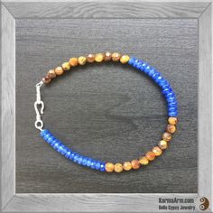 This delicate friendship bracelet combines the properties Blue Jade + Golden Tiger Eye in a colorblock design.