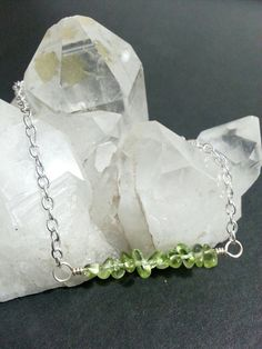 Check out this item in my Etsy shop https://www.etsy.com/listing/470406062/peridot-silver-plated-bar-chain-bracelet