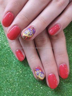 Coral gel polish with pansy one stroke flower nail art