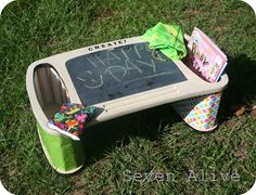 Take an old T.V. tray and turn it into an activity table for your kids.  Great of coloring and games.