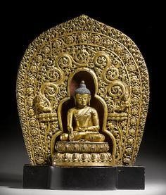 A gilt copper alloy figure of Shakyamuni with prabhamandala Tibet, circa 15th century