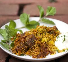 Biryani - a beautifully spiced Indian casserole of lamb curry layered with saffron rice - with minty cucumber raita on the side.