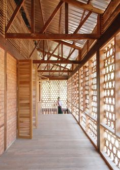 Thazin High School in Myanmar by Ackermann+Raff Architects. Simplicity in plan, beautiful combination of materials, and detailed to encourage natural air movement through the latice weave - which is also architecturally playful whilst giving privacy and shading to the circulation zone.