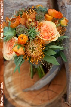 Orange & peach bridesmaid bouquet with succulents & tillandsia | Flowers by Third Bloom