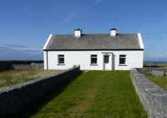 Aran Islands, Inishmore cottage of Peter Conneelly, dry stone builder who built the house himself as well as many walls and who died at the age of 106 in 2011. This photo shows the house that he built himself where he raised his family of nine daughters. , www.enjoy-irish-culture.com