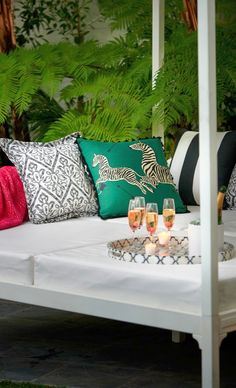 Revered for its incomparable quality, taste and style, Scalamandre has fashioned the fabric of the Scalamandre Zebras Print Emerald Outdoor Pillow exclusively for Frontgate's outdoor collection. | Frontgate: Live Beautifully Outdoors