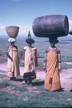 Africa | Be it a bottle, a basket or a barrel, Xhosa women carry most goods on their heads. Eastern Cape - Transkei. South Africa. | Lister Haig Hunter.
