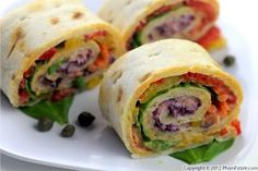 These colorful pinwheel sandwiches are loaded with Mediterranean flavors. Fresh and roasted vegetables are brought together with hummus and pleasingly tart capers. The cabbage and carrots were also briefly pickled in lemon juice and a little sugar to add a little brightness without sacrificing their crunch.