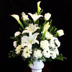 Sympathy White Flower Arrangement in a Urn. visit us at www.gardenofroses.us @IE_Florist #reallocalflorist