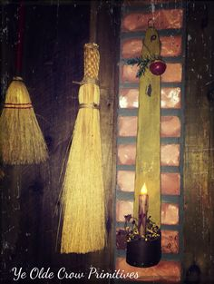 Old brooms candle scone w jingle bell by Ye olde crow primitives.