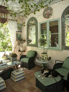 Covered porch with mirrors on wall