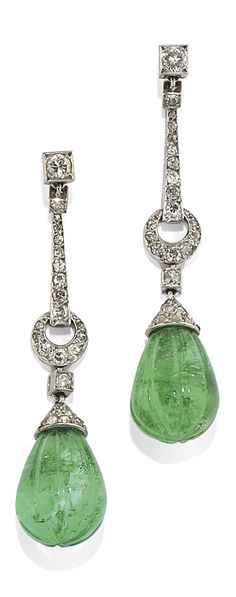 A PAIR OF ART DECO PLATINUM, EMERALD AND DIAMOND EAR PENDANTS, CIRCA 1920. #ArtDeco