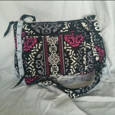 VERA BRADLEY PURSE × Authentic Vera Bradley  × Canterbury Magenta pattern* × Adjustable strap × Can be shoulder purse or cross body × Lots of compartments  × Has a zippered built-in wallet compartment  × Used MAYBE twice × Basically brand new  I have too many Vera Bradley purses so it's time to sell some   *Also selling matching wallet   |o|REASONABLE OFFERS CONSIDERED |o|APPROPRIATE TRADES ENTERTAINED |o|BUNDLES ARE ENCOURAGED! Vera Bradley Bags