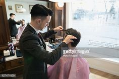 Stock Photo : Barber cutting man