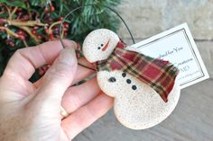 Perfect for those who appreciate primitive! This salt dough snowman ornament is rolled with a slight cinnamon dough, giving him his lovely light brown color. Not as dark as a gingerbread ornament but