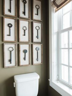Foyer + Powder Room Pictures From HGTV Smart Home 2016 : A collection of framed vintage keys decorate the back wall of the powder room, with a ribbon trim adding interest to the window shades. Bathroom Wall Decor, Small Bathroom, Key Wall Decor, Foyer Wall Decor, Niche Decor, Bathroom Niche, Concrete Bathroom, White Bathrooms, Entryway Wall