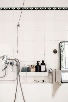 White retro bathroom details. Like the liner tile.