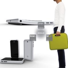 """The Smart Plus is a combination of a laptop case, projector keyboard and a Smartphone. There is no screen or a dedicated hardrive involved in the setup; the Smartphone itself is the """"brains"""" in this combo. The inside of the case doubles up as a screen and the projector beams images to it or any other surface you desire. All of it together can be used as a laptop, gaming console or a phone."""